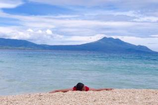 Rest in the shore. Behind is Mt. Malindig standing firm